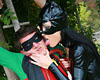 Dominant cat bitch captures rubbin  latex clad catwoman toys with male superhero. Latex clad catwoman toys with male superhero.